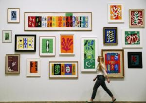 File photo of an employee posing with Henri Matisse's artworks at the Tate Modern gallery in London